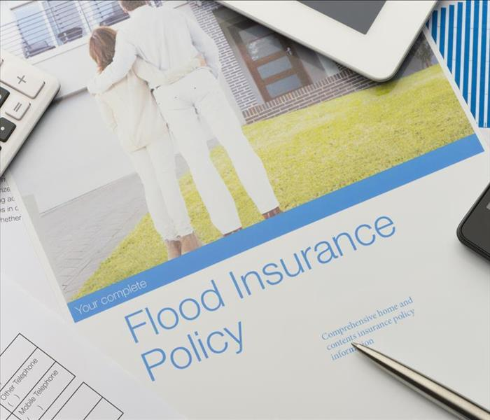 pic couple and flood insurance policy on paper